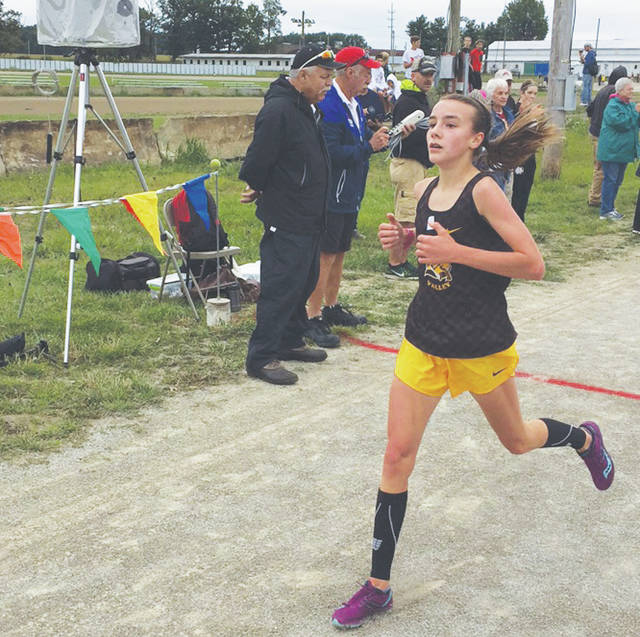 Buckeye Valley's Chloe Dawson competes in a cross country meet last season.