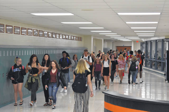 "Students at Delaware Hayes High School return to classes after lunch Wednesday during the first day of school. Principal Dr. Richard Stranges helped guide students to their classes and lockers and learn their new schedules. Stranges said making a good first impression on students ""sets the tone for the year."""
