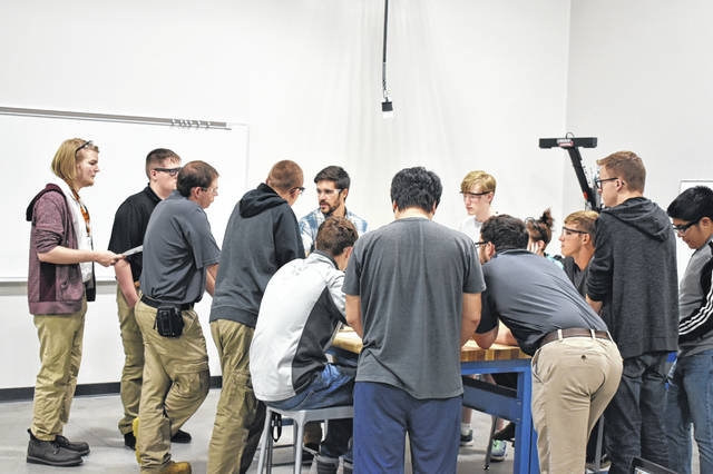 Engineering students get a lesson from their instructor, Nick Steffen, Tuesday in the new engineering program lab. The lab is one of the corners of the new wing of the Consolidated Campus and boasts four different spaces for labs, classrooms and workspaces.