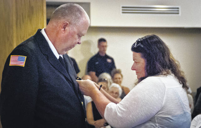 "Before her husband, Clyde ""Butch"" Vanhoose, was sworn-in as Orange Township's fire inspector, Catherine VanHoose pinned his badge to his dress uniform jacket."