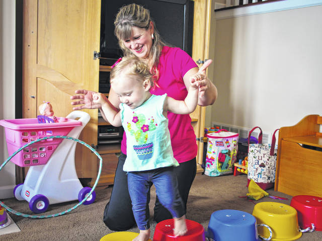 Taryn Cook might think she and her mother, Sarah, are playing a game of hopping across the stones of a stream but they are really doing therapy to strengthen the muscles of her legs that help her balance and walk. According to Sarah, through the services provided by the Delaware County Board of Developmental Disabilities, Taryn has made great progress to the point she is walking, running, singing and talking in multi-word sentences.