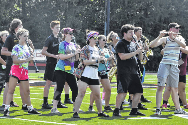 The woodwind section of the Delaware Hayes High School Marching Band plays through a section of this year's show Thursday. Members of the band practiced from 9 a.m. to 9 p.m. last week week and endured temperatures that nearly reached 90 degrees.