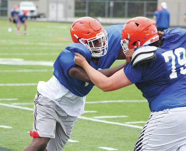 Olentangy Orange lineman Zach Harrison, left, works against Jared Pack during a practice earlier this summer.