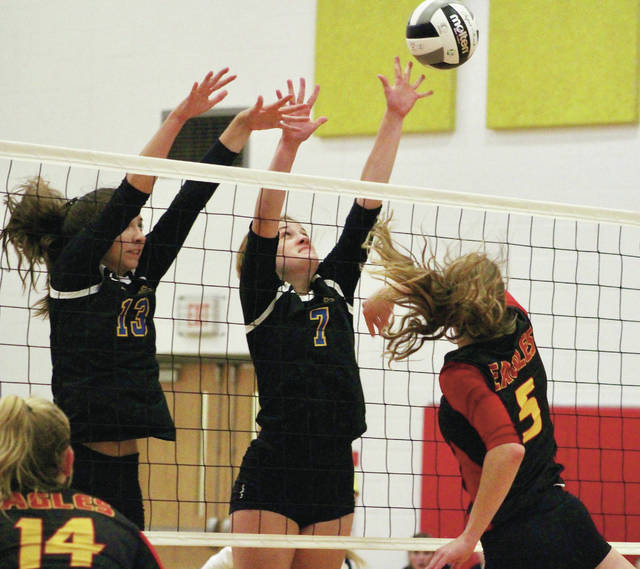 Olentangy's Abby O'Donnell (7) and Anna Cecil attempt to block the shot of Big Walnut's Kassie Bowmar (5) during Tuesday's non-league showdown in Sunbury. The Braves won in five sets.