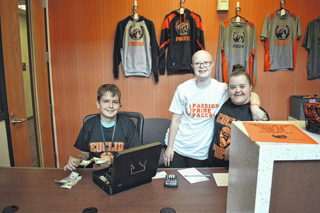 From left to right: Kayden Leach, Nathalie Young and Remington Graffice operate The Winner's Circle Friday morning at Hayes High School. Job Coach Ronda Threlfall said running the store helps the students gain business, social and customer service skills.