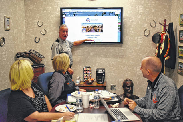 Delaware Hayes High School Principal Richard Stranges gives a presentation about preparing for the Blue Ribbon of Excellence evaluation to Vice Principal Rex Reeder, right, Hayes Administrative Assistant Susan Backus, left, and Susan Wells, a community member and supporter of Delaware City Schools, middle left.