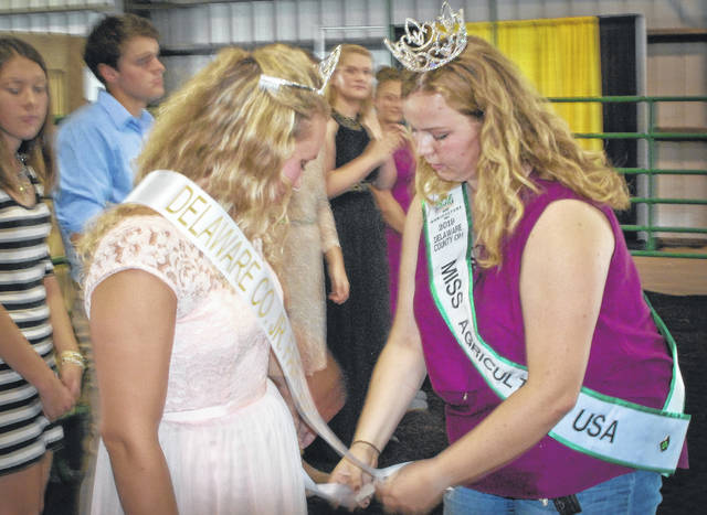 Lauren VanGundy, left, was named the 2018 Delaware County Junior Fair Queen by the Junior Fair Board Saturday afternoon as the 2018 Delaware County Fair got underway. Miss Agriculture USA for Delaware County Bree Vining, right, had the honors of crowning VanGundy and placing a sash around her.
