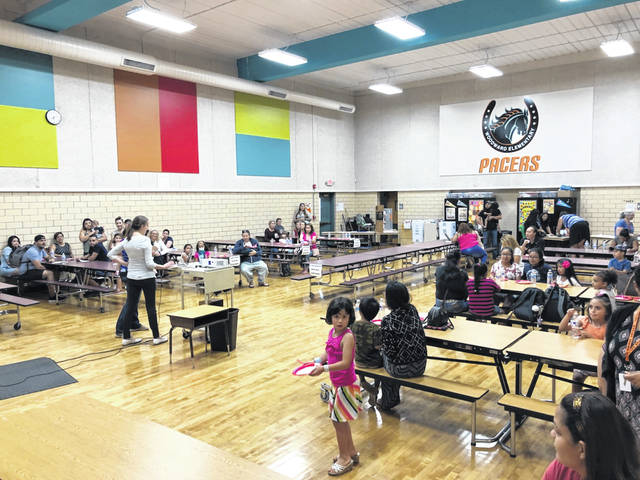 Families gathered at Woodward Elementary Thursday evening for the first English Learner Family Night, which allowed families and students to ask questions about the English Learner program. The event also featured activities for students such as a piñata.