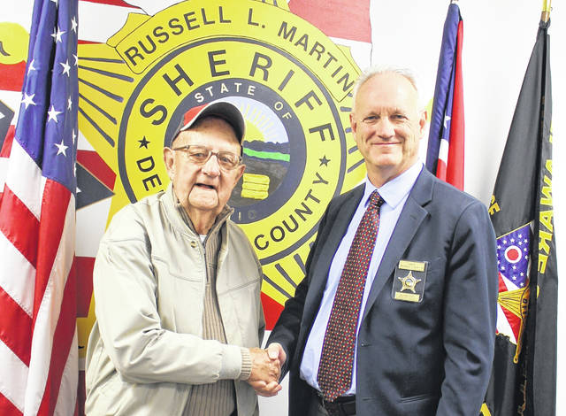 "Pictured are former Delaware County Sheriff Eugene Jackson, left, with current Sheriff Russell Martin, right, at the Delaware County Sheriff's Office in 2016. Martin said Monday that he was grateful for the 2016 visit. He added Jackson was ""a true hero who served not only his country, but the citizens of Delaware County as a well-respected sheriff from 1966 to 1976."""