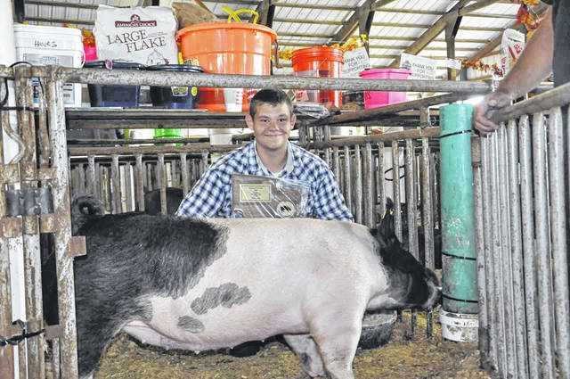 Bryce Hayes took home the Grand Champion Gilt Award for his 264-pound hog.