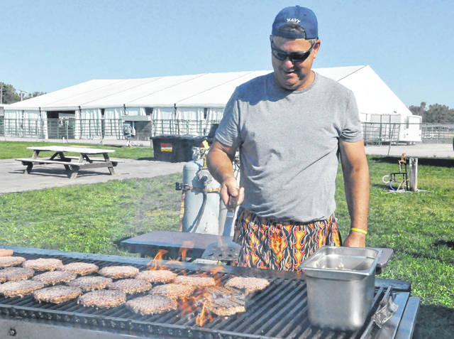 Prior to Tuesday's lunch rush at the Delaware County Fair, Jim Severance grills up some hamburgers. Severance and his wife, Julie, have operated the build your own half-pound burger stand at the fair for over 15 years. The Ostrander couple noted the stand is a family tradition dating back over 50 years.