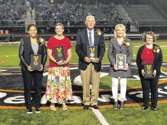 During halftime of Friday's Delaware Hayes High School football game, the newest members of the Delaware City Schools Distinguished Alumni Hall of Fame were introduced. Pictured, left to right, are the new inductees: Carrie Banks (1996), April Nelson (1974), Richard Andrus Hagar (Willis, 1954), Jeannee Parker Martin (1973) and René Landon Weber (1974). Douglas Baxter (1968) is not pictured.