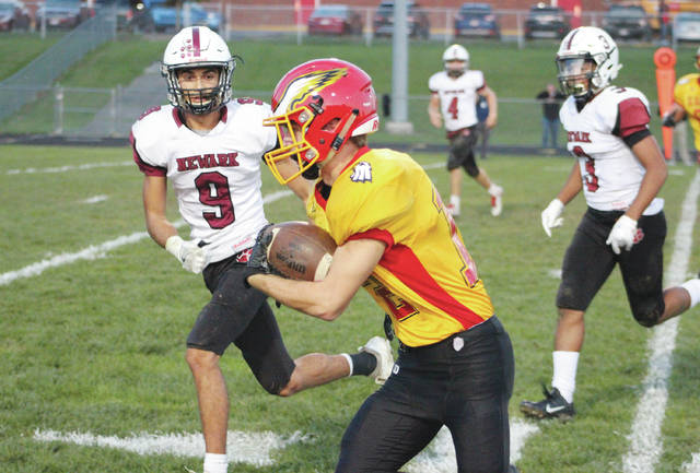 Big Walnut's Jake Summers sprints down the sidelines as Newark's Louie Cook (9) pursues during the first half of Friday's OCC showdown in Sunbury.
