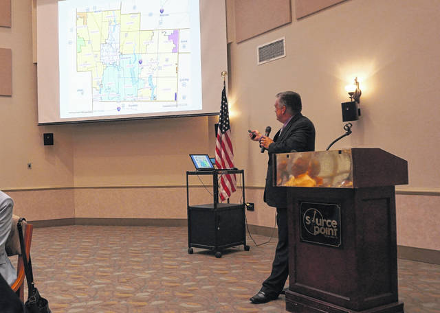 Delaware City Schools Superintendent Paul Craft shows a map of all the school districts in Delaware County during the State of Schools event held at SourcePoint on Sept. 27.