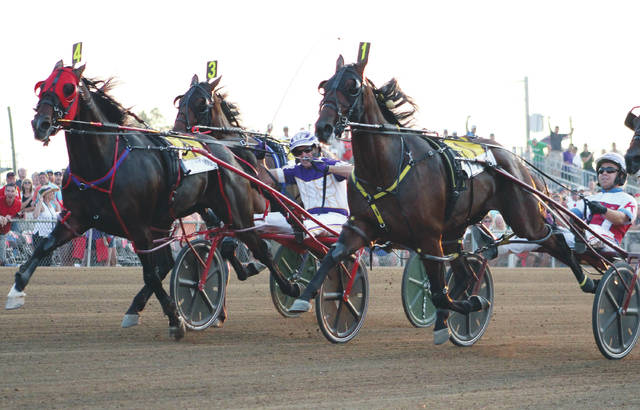 Courtly Choice (4) and David Miller get up in the final strides to defeat Dorsoduro Hanover (1) in 1:49 4/5 to win the 73rd Little Brown Jug Thursday at the Delaware County Fair.