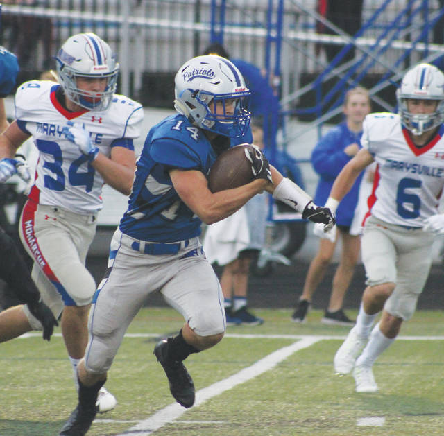 Olentangy Liberty's Aidan Kenley (14) finds some running room in the first half of Friday's non-league battle against visiting Marysville.