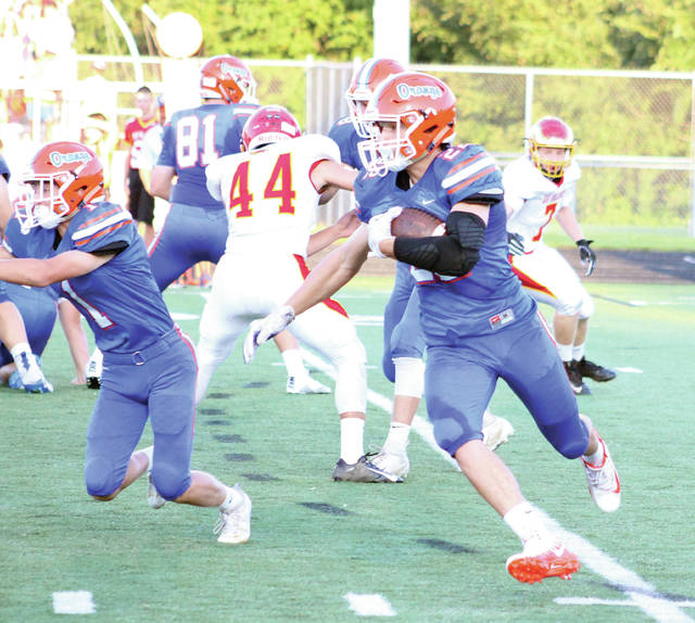 Orange's Jake Vanchieri looks for running room during the first quarter of Friday's non-league showdown against visiting Big Walnut. He found it, too, breaking free for a 77-yard touchdown on the play.