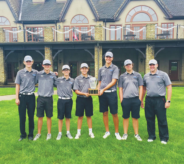 Members of the Olentangy Liberty boys golf team stand with their trophy after winning Monday's Delaware Cup at Royal American.