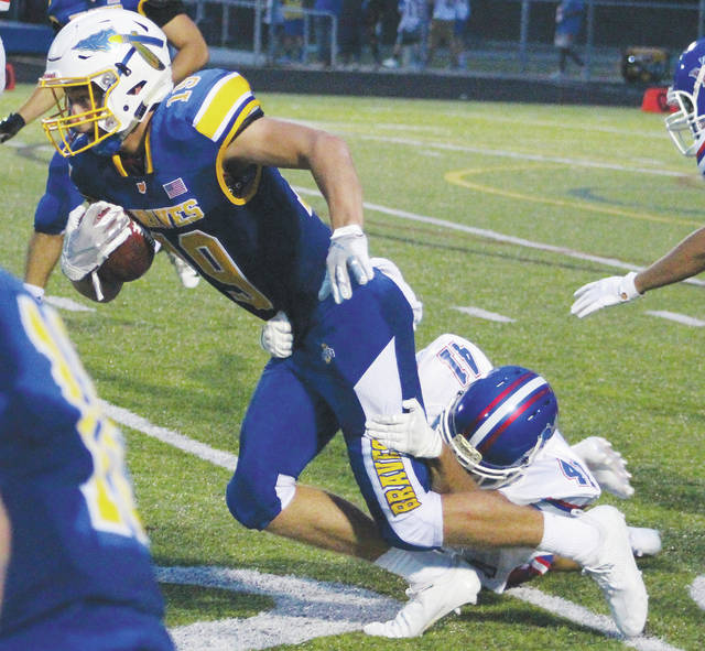 Olentangy's Jace Middleton tries to shake free from Springfield's Montryce King (41) during the first half of Friday's non-league showdown in Lewis Center.