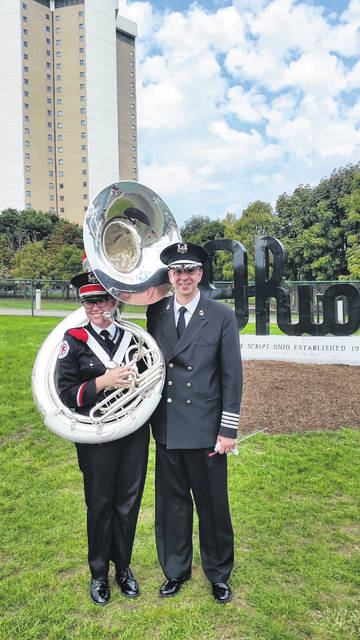 OSU senior and former Hayes student Anna Hurley is pictured with The Ohio State University Band Director Dr. Christopher Hoch. Hurley said when she was younger, Hoch taught her to play tuba. She attributed some of her success in the The Ohio State University Marching Band to him.
