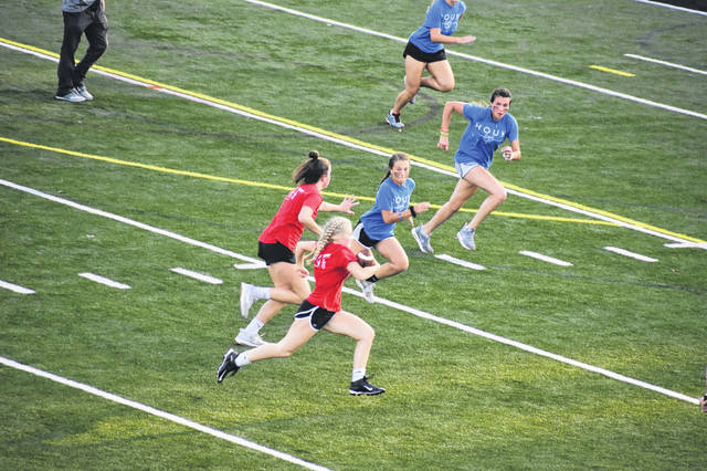 Ridge House player Elise Mays runs the ball during the powder puff game Wednesday night. Ridge House took second in the competition and scored 106 points.