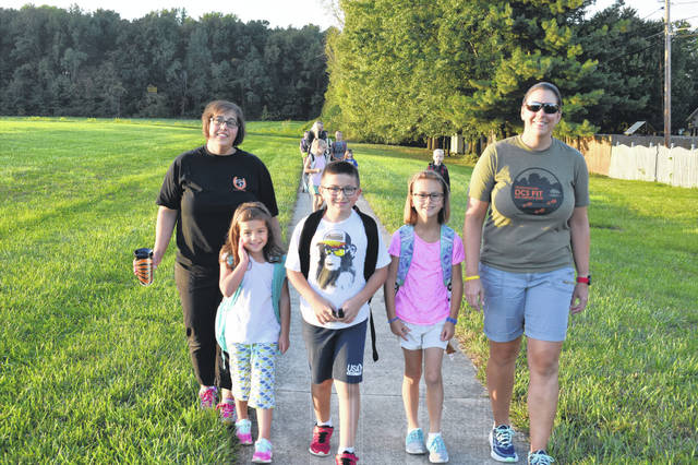 Gina Picetti and her two children, Gabriella and Angelo, walk to Schultz Elementary School in Delaware with Hailey and Jamie Cehres Wednesday morning during Walk to School Day.