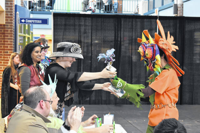 "Lewis Center teenager Nathan Morris is presented his Grand Champion award for his cosplay of Skull Kid from ""The Legend of Zelda: Majora's Mask"" during the cosplay competition Saturday. Morris said the costume was homemade and took about 40 hours of work."