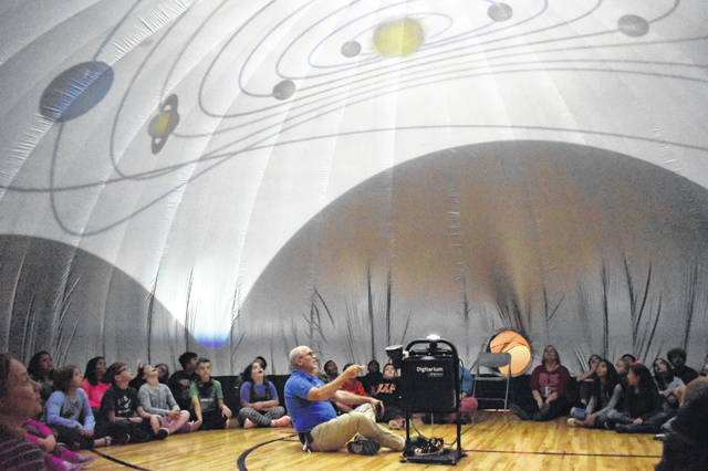 Educator David Killion gives a presentation about the solar system to a group of Carlisle Elementary School students Monday afternoon. Killion gave presentations to all the students at Carlisle. He talked about the eight planets and the dwarf planets in the solar system, constellations and the North Star.
