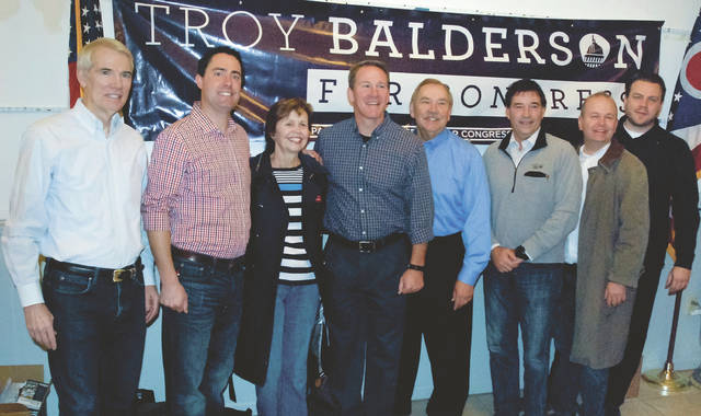 Before marching off into the rain Saturday to knock on doors, volunteers heard from former Congressman Pat Tiberi, Bob Paduchik, Republican National Committee Co-Chair, and (pictured left to right) Ohio Sen. Rob Portman, state Rep. Frank LaRosa, Delaware County Commissioner Barb Lewis, Secretary of State Jon Husted, Delaware County Auditor George Kaitsa, Congressman Troy Balderson, State Rep. Andrew Brenner, and Delaware County Assistant Prosecutor Andrew King.