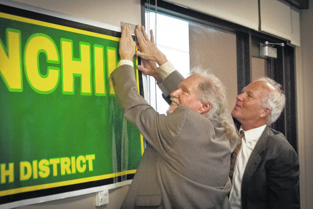 The Ohio Green Party sponsored a town hall Saturday evening at the Delaware Community Center YMCA/Ohio Army National Guard Readiness Center in Delaware. Candidates Joe Manchik (left), Ohio 12th Congressional District, and Gary Cox, Ohio Senate District 19, work on posting Manchik's campaign sign on the wall just before the forum started.