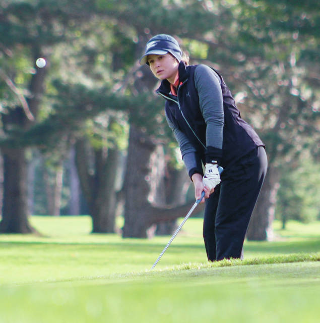 Orange's Riley Dean chips onto the green during the Division I state girls golf championship Friday at OSU Golf Club.