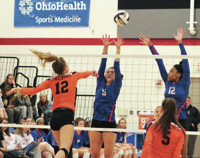 Olentangy Orange's Sidney Gossard (5) and Tazmin Appiah (12) attempt to block a shot from Delaware Hayes' Hadlee Bruns during the second set of Thursday's Division I district semifinal in Whitehall.