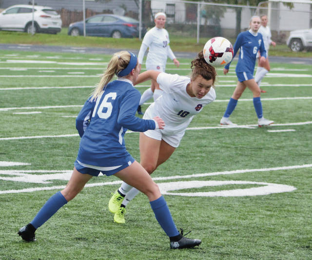 Orange's Addie Masters (10) heads the ball away from Olentangy's Carly Ross (16) during the first half of Saturday's Division I district championship in Grandview.