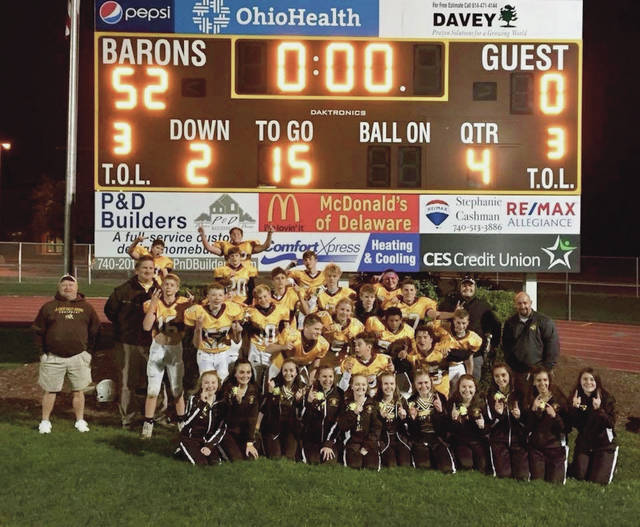 Buckeye Valley's eighth grade football team celebrates after wrapping up a perfect campaign with a 52-0 win over Marion Grant earlier this month in Delaware.