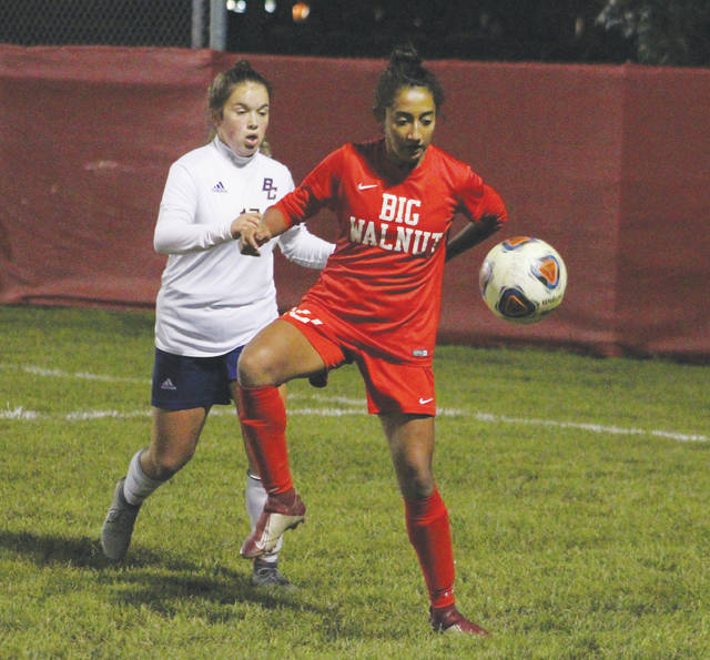Big Walnut's Kimberly Serna collects the ball in front of a Bloom-Carroll defender during the first half of Tuesday's Division II district semifinal in Sunbury.