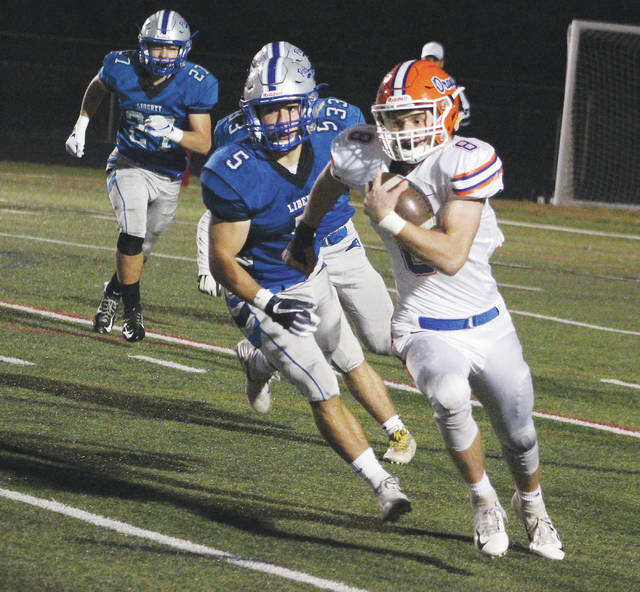Orange's Robbie Dayhuff finds some running room during the first half of Friday's OCC game against host Liberty.