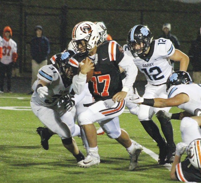 Hayes quarterback Blake Eiland (17) powers forward for some hard-earned yards during the second half of Friday's league showdown against visiting Hilliard Darby.
