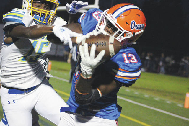 Orange's Zach Harrison (13) hauls in a touchdown in front of Olentangy's D'Ante Ables during the first half of Friday's key OCC clash in Lewis Center.