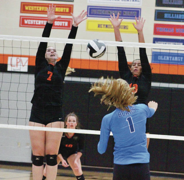 Hayes' Kaiden Murphy (7) and Isis Price combine for a block during the first set of Thursday's OCC finale against visiting Berlin.