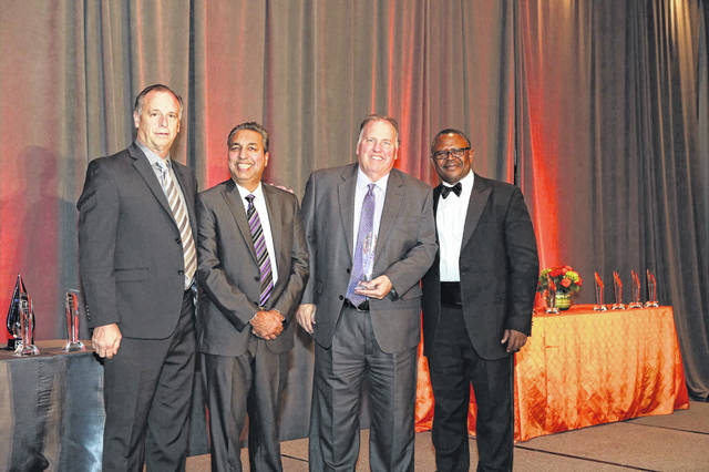 The Columbus Zoo and Aquarium accepts the Corporation of the Year Award at the Ohio Minority Supplier Development Council 2018 Annual Awards Gala in West Chester on Nov. 16. Pictured, left to right, are Tracy Murnane, Sharad Thakkar, Ph.D; Greg Bell and Christopher Che.