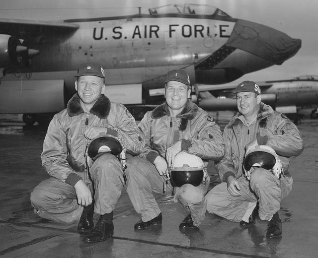 Allen, far left, is pictured at Lockbourne Air Force Base in Columbus with two crew members. The photograph of the trio was taken back in the late 1950s.