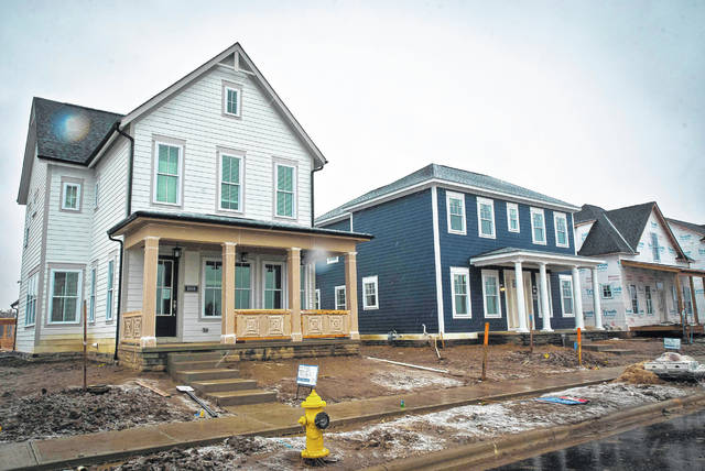 Evans Farm broke ground in late 2016. On Wednesday, Tony Eyerman, co-owner of the Evans Farm Land Development Company, said the first few homes (pictured) of the new walkable community in Lewis Center will be ready for move in a few weeks before Christmas.
