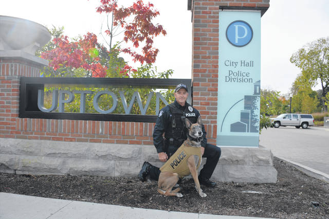 Westerville Police Officer Bryan Schwartz is pictured alongside Fiji, his K9 partner.