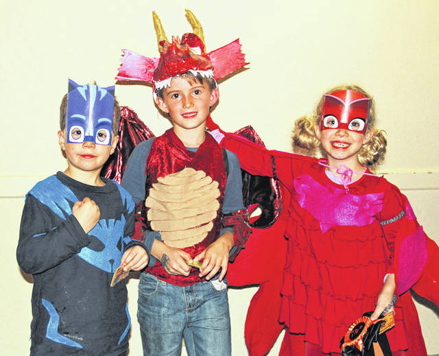 Pictured are the winners of the group division in the Village of Galena's Halloween Costume Contest. They are, left to right, Joshua Hartzler, Michael Steinmetz and Kate Hartzler.