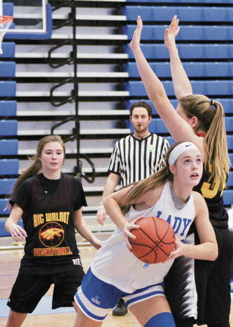Olentangy Berlin junior Jessica Nation (center) fights through a crowd in the Bears' scrimmage against Big Walnut earlier this month.