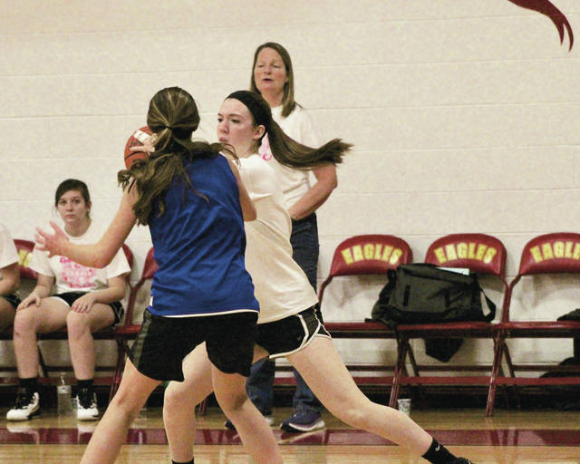 Delaware Christian senior Hannah Maurer (center) looks for a pass in the Eagles' scrimmage against Grove City Christian last week. The DCS girls basketball team opens at home Friday at 6:30 p.m. against Centerburg in non-league play.