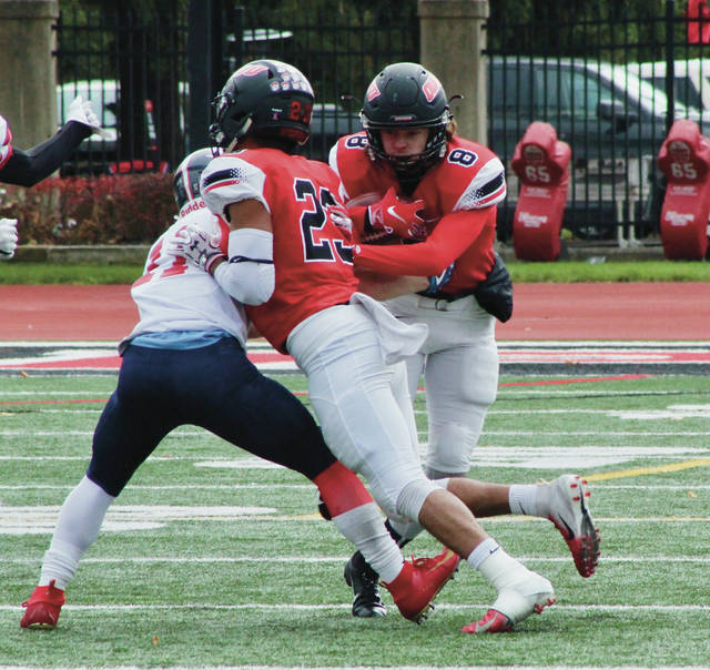 OWU's Nick Heidel (8) returns an interception in the first quarter of the Bishops' 40-12 win over Hiram to close the season Saturday afternoon at Selby Stadium.