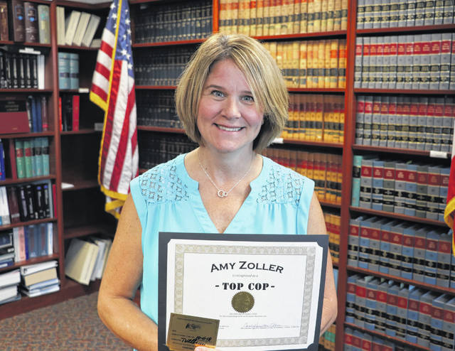 Amy Zoller poses with her Top Cop award.