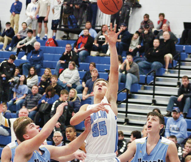 Olentangy Berlin's Grant Schrieber (55) puts up a shot in the first half of Thursday's season opener against visiting River Valley. Schrieber led the Bears with 18 points.