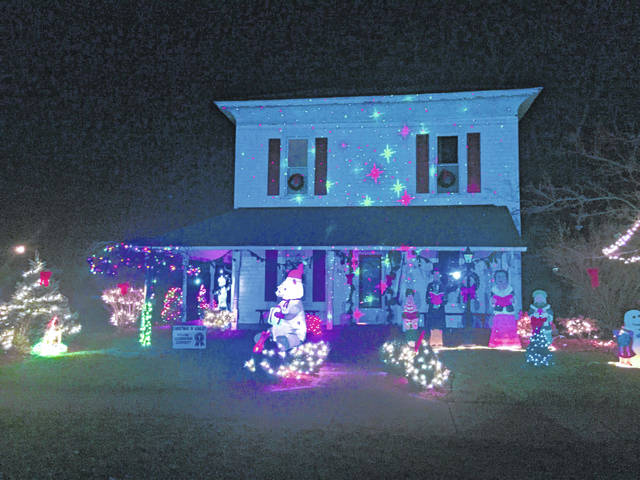 According to organizers, the top cash prize awarded for the best exterior lighting of a house this year is $200. All homes in the village of Ashley are eligible, and the judging will happen the day before the event. The home in the photo is one of the 2017 winners.